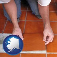alaska a tile worker laying ceramic floor tile