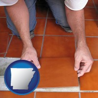 arkansas a tile worker laying ceramic floor tile