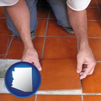 arizona map icon and a tile worker laying ceramic floor tile