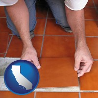 california a tile worker laying ceramic floor tile