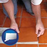 connecticut a tile worker laying ceramic floor tile