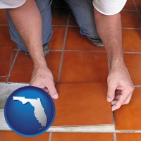 florida a tile worker laying ceramic floor tile