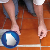 georgia a tile worker laying ceramic floor tile
