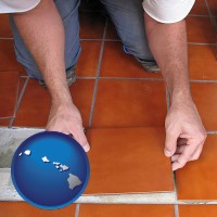 hawaii map icon and a tile worker laying ceramic floor tile