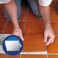 iowa a tile worker laying ceramic floor tile