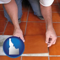 idaho map icon and a tile worker laying ceramic floor tile
