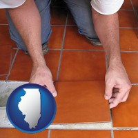 illinois a tile worker laying ceramic floor tile