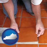 kentucky a tile worker laying ceramic floor tile