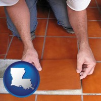 louisiana a tile worker laying ceramic floor tile