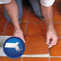 massachusetts a tile worker laying ceramic floor tile