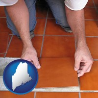 maine a tile worker laying ceramic floor tile