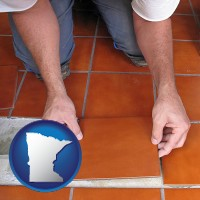 minnesota a tile worker laying ceramic floor tile