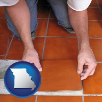 missouri a tile worker laying ceramic floor tile