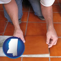 mississippi a tile worker laying ceramic floor tile