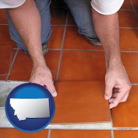 montana a tile worker laying ceramic floor tile