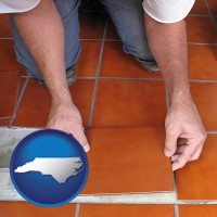 north-carolina a tile worker laying ceramic floor tile