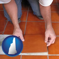 new-hampshire a tile worker laying ceramic floor tile