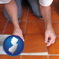 new-jersey a tile worker laying ceramic floor tile