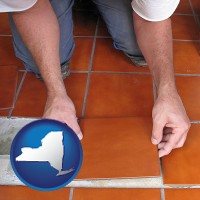 new-york a tile worker laying ceramic floor tile