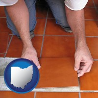 ohio a tile worker laying ceramic floor tile