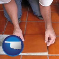 oklahoma a tile worker laying ceramic floor tile