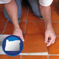 oregon a tile worker laying ceramic floor tile