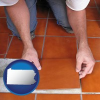 pennsylvania a tile worker laying ceramic floor tile