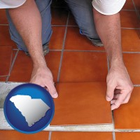 south-carolina a tile worker laying ceramic floor tile