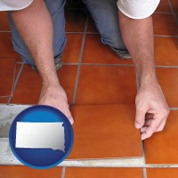 south-dakota a tile worker laying ceramic floor tile