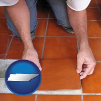 tennessee a tile worker laying ceramic floor tile