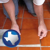 texas a tile worker laying ceramic floor tile
