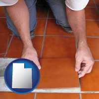 utah a tile worker laying ceramic floor tile