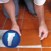 vermont a tile worker laying ceramic floor tile