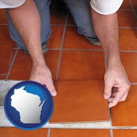 wisconsin a tile worker laying ceramic floor tile