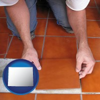 wyoming a tile worker laying ceramic floor tile