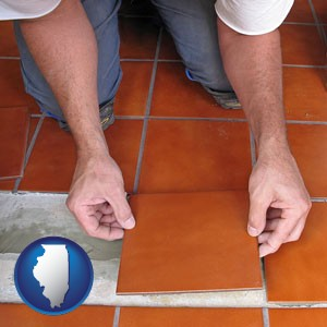 a tile worker laying ceramic floor tile - with Illinois icon