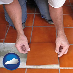 a tile worker laying ceramic floor tile - with Kentucky icon