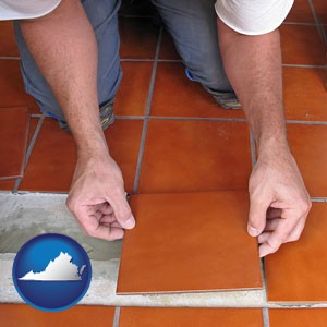 a tile worker laying ceramic floor tile - with Virginia icon