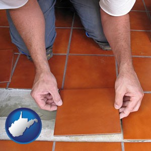 a tile worker laying ceramic floor tile - with West Virginia icon